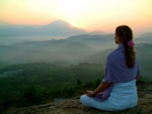 istock_000000981376xsmall_women_meditating_overlooking_mts